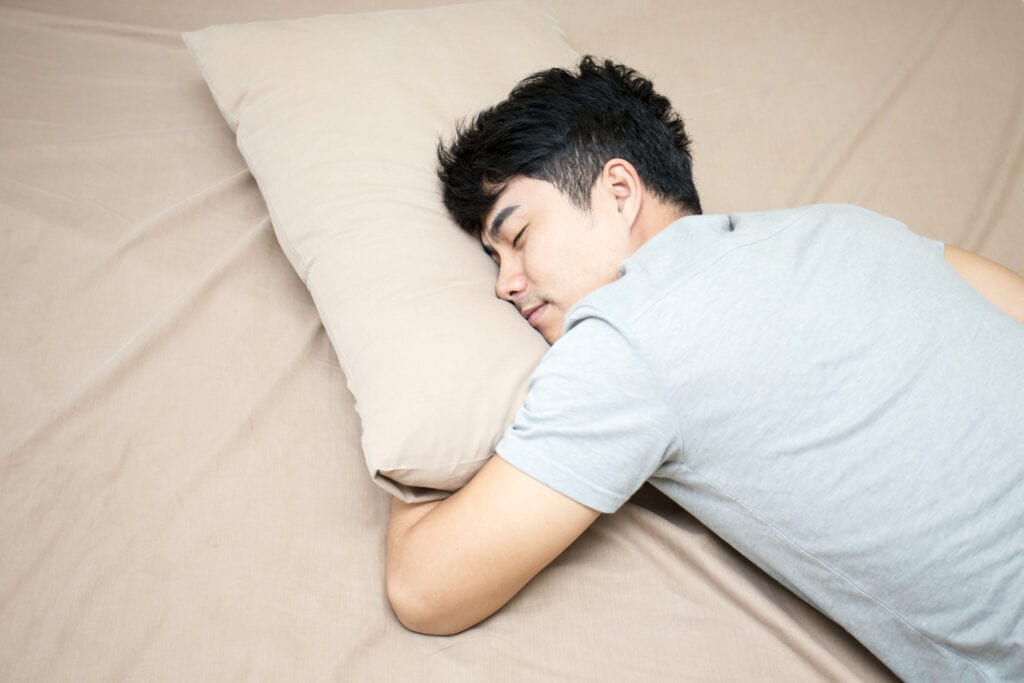 Man sleeping with pillow